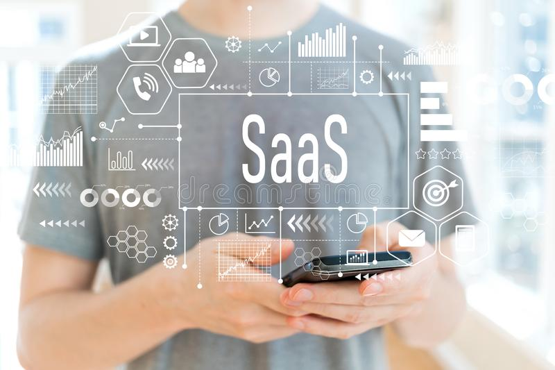 SaaS with man using a smartphone. SaaS with young man using a smartphone royalty free stock photo