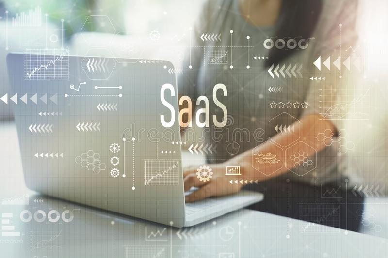SaaS with woman using laptop. SaaS with woman using her laptop in her home office royalty free stock photography
