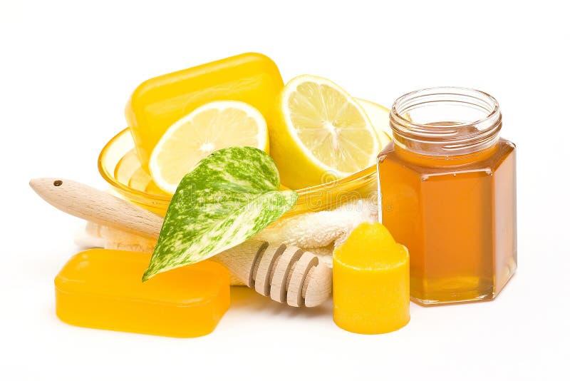 Sabão de Glyceryn, frasco do mel e limão fotografia de stock