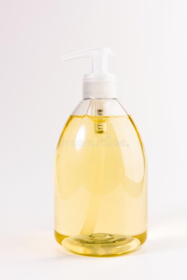 Sabão líquido amarelo isolado em um branco foto de stock royalty free