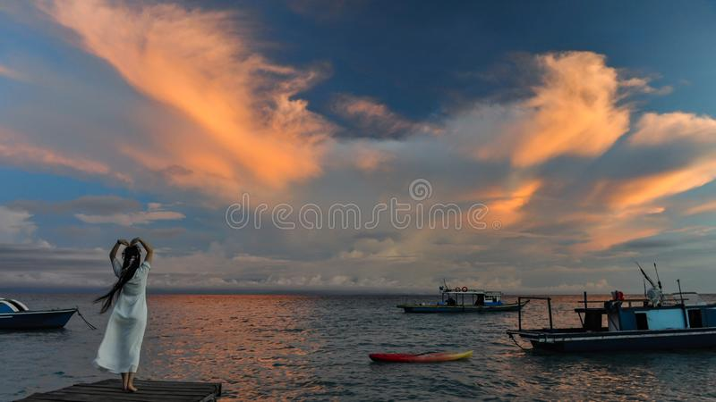 Sabah Mermaid Island. Mantanani Island is nicknamed Mermaid Island. It is a 30-minute ferry ride from Kota Kinabalu. It consists of three outlying islands. It is royalty free stock image
