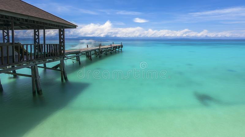 Sabah Mermaid Island. Mantanani Island is nicknamed Mermaid Island. It is a 30-minute ferry ride from Kota Kinabalu. It consists of three outlying islands. It is royalty free stock photos