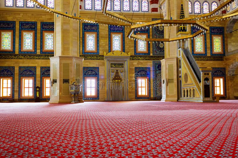 Sabanci Central Mosque interior inside in Adana, Turkey. Adana, Turkey, 08.20.2014: The largest Turkey`s Sabanci Central Mosque interior inside, walls and stock photography