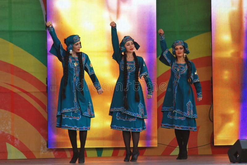 Sabantui celebration in Moscow. Three women performers stock photos