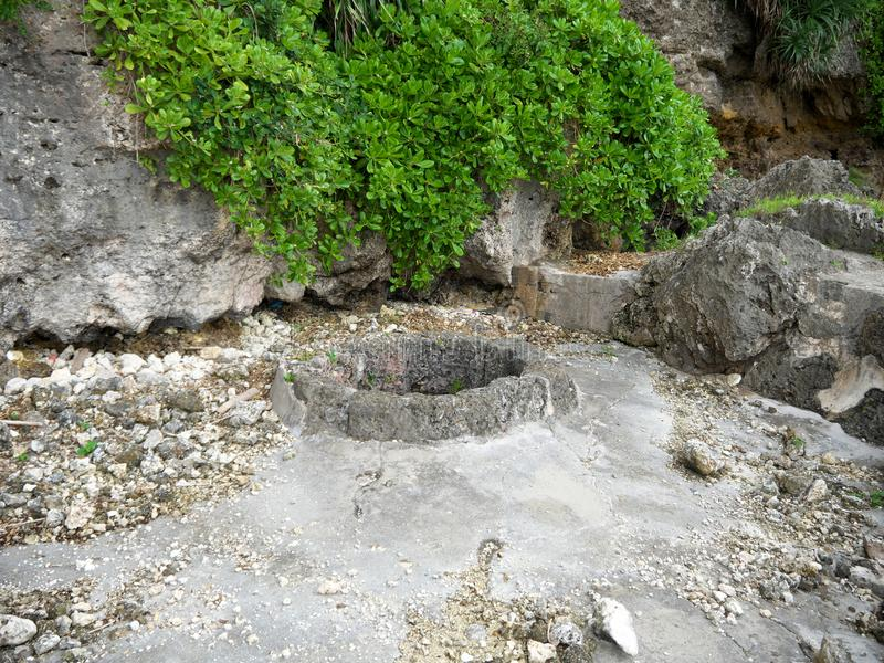 Sabautsuga, the only well at the east of Irabu island. People used to go down 124 stone steps. stock photography