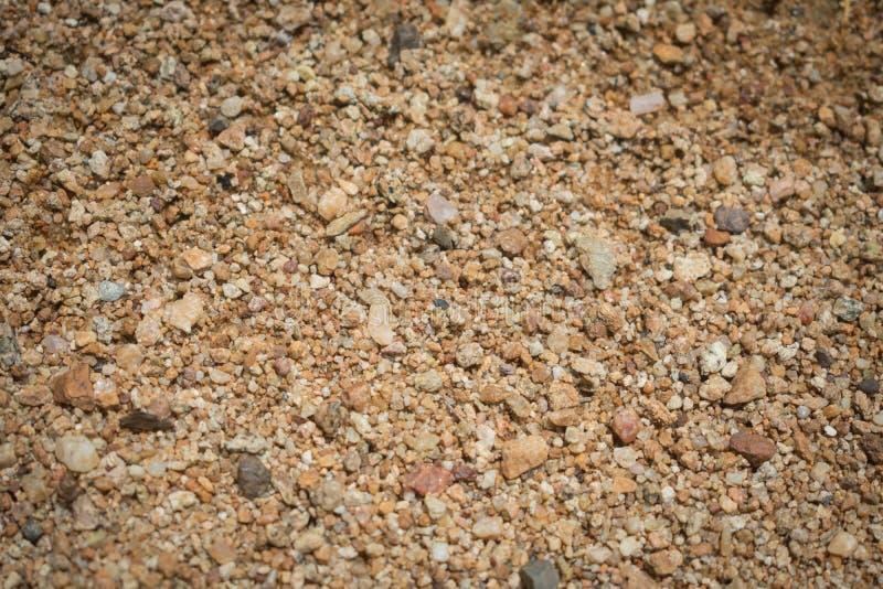 Sabbia grezza naturale Grani di superficie del primo piano della sabbia immagine stock