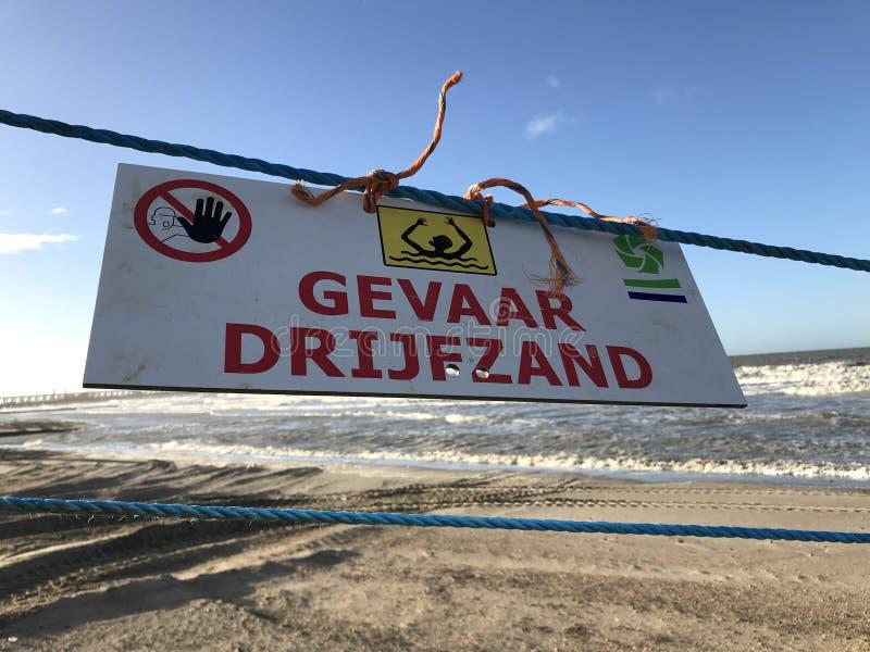 Sabbia olandese dell'azionamento del segnale di pericolo fotografia stock libera da diritti