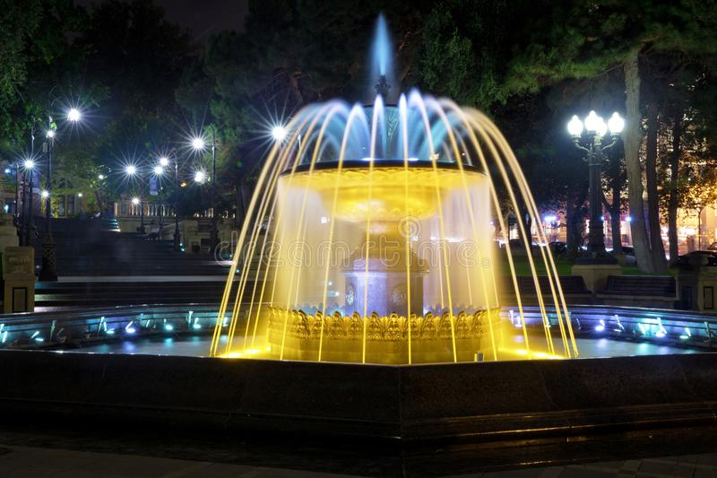 Sabir square fountain, Baku, Azerbaijan at night. The fountain in the city center. Baku Azerbaijan . night vision of a round park stock photos