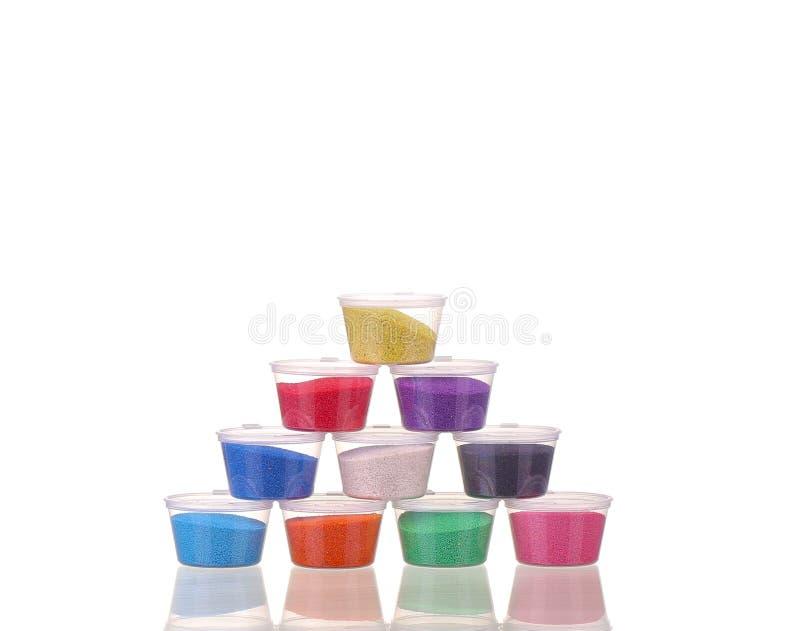 Sable coloré dans des pots photos stock
