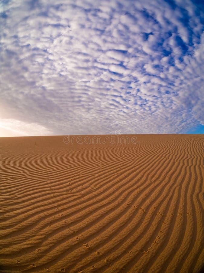 Sable et nuages photographie stock libre de droits