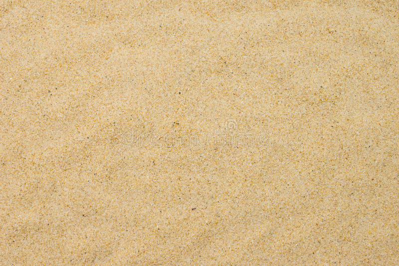 Sable fin de plage dans le soleil d'été photographie stock libre de droits