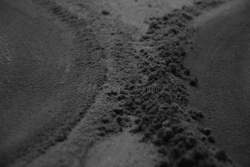 Sable noir photo libre de droits