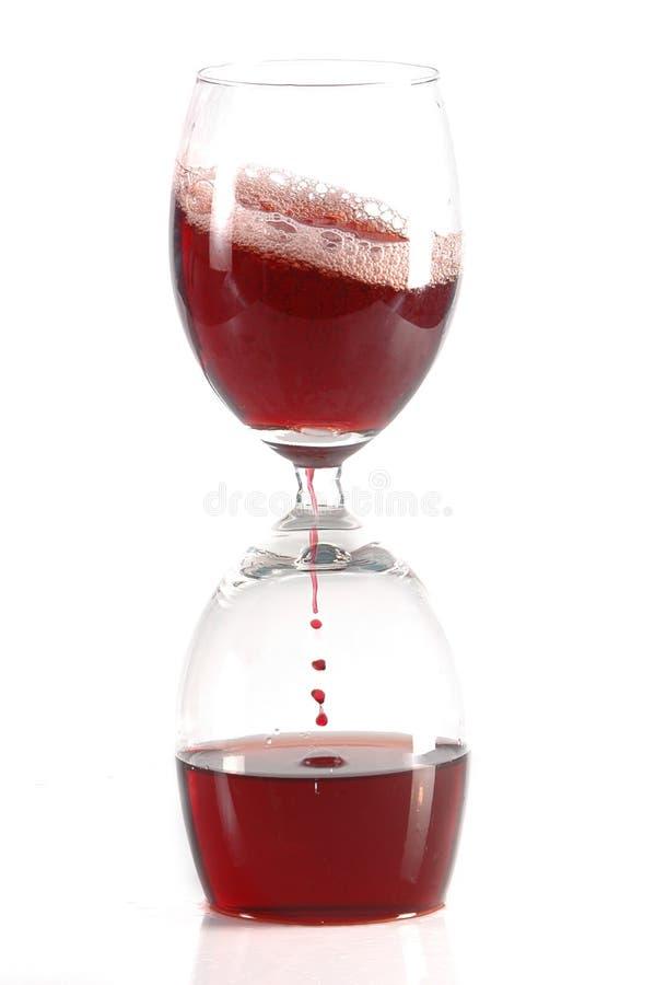 Sablier des glases du vin rouge photo stock