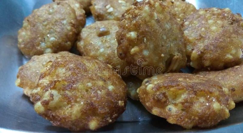 Sabudana Wada. A closeup click of potato based fresh and fried Sabudana wada snack in a pan stock photography
