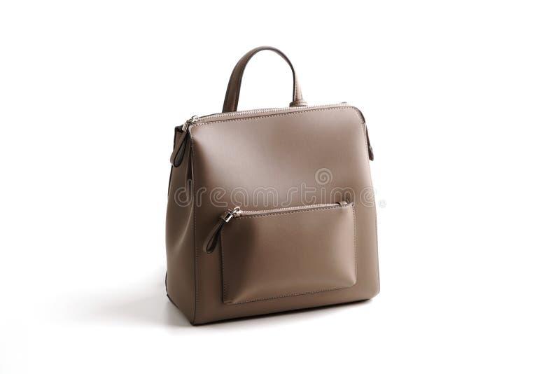 Sac à dos femelle en cuir gris de luxe de sac, d'isolement photo stock