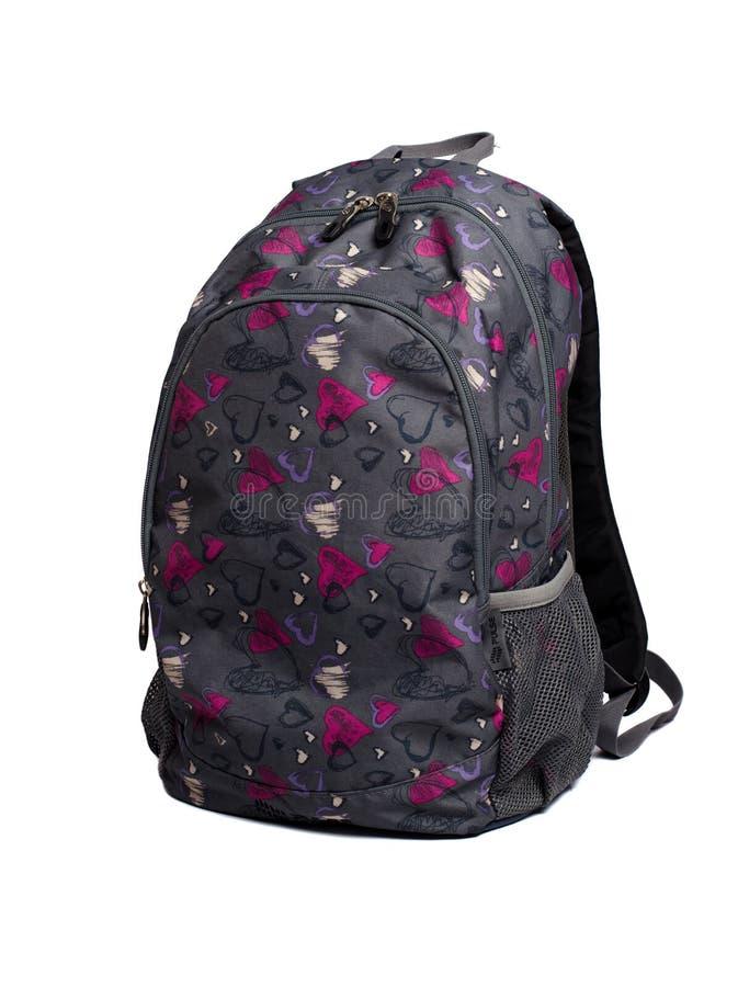 Sac à dos gris avec des formes pourpres et roses de coeur photographie stock libre de droits