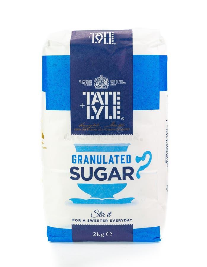 Sac de sucre granulé de Tate et de Lyle Fond blanc images stock