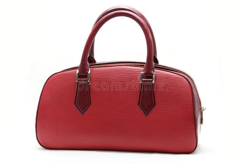 Sac en cuir faux rouge de femme photographie stock libre de droits