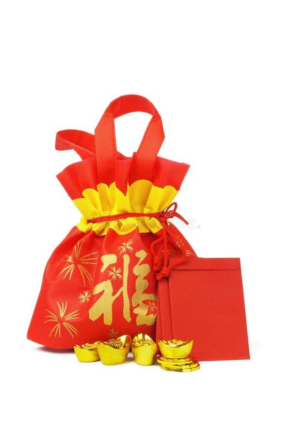 Sac et ornements chinois de cadeau d'an neuf photographie stock libre de droits