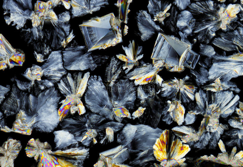Saccharose crystals in polarized light. Microscopic view of a saccharose crystals. Polarized light, crossed polarizers royalty free stock photography