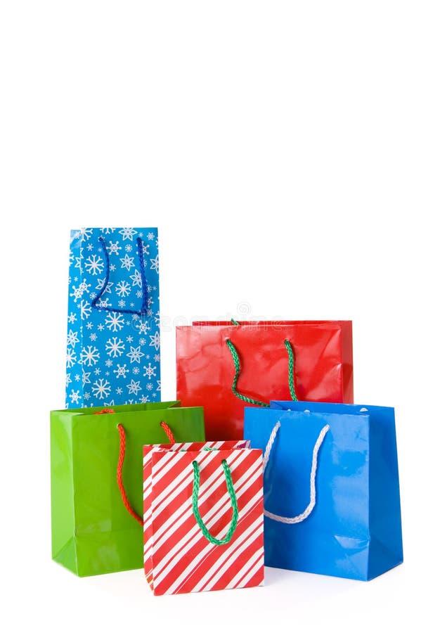 Sacchetti del regalo di natale su bianco fotografia stock libera da diritti