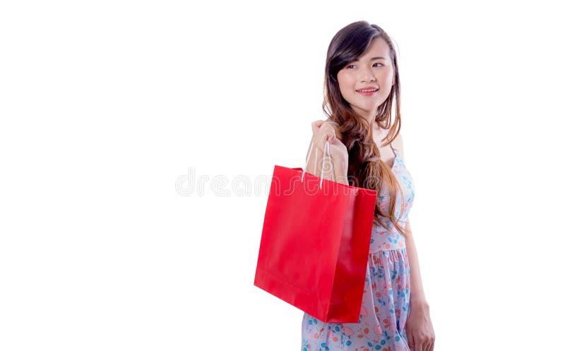sacchetti della spesa emozionanti felici di condizione e della tenuta della donna fotografie stock