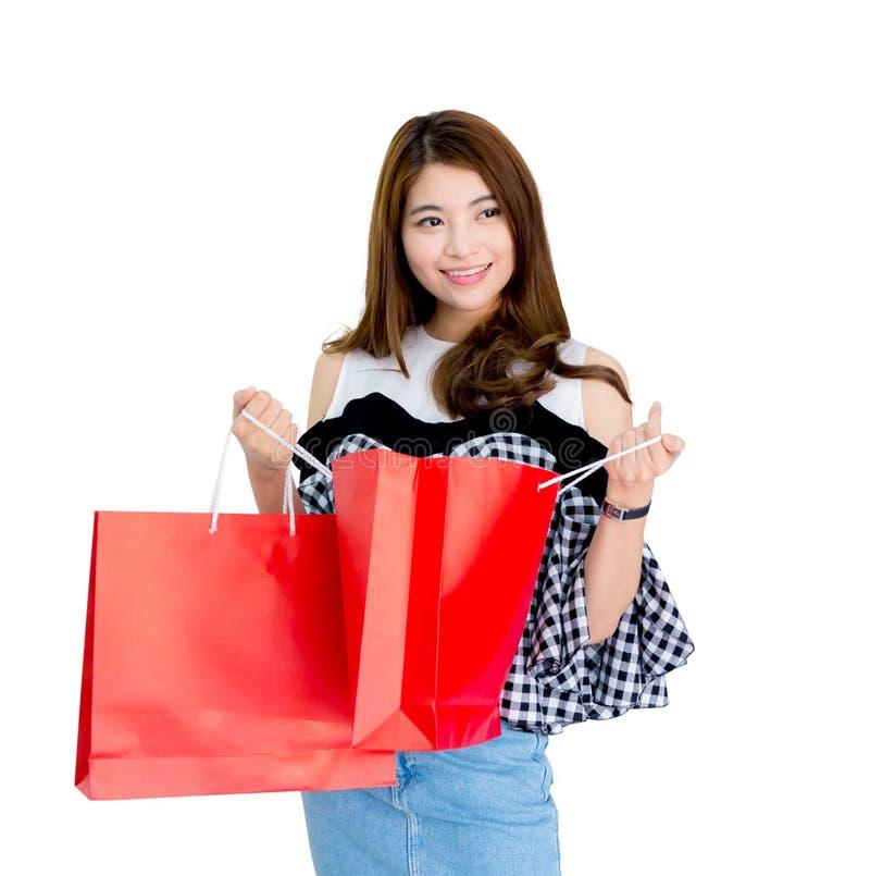 sacchetti della spesa emozionanti felici di condizione e della tenuta della donna immagini stock libere da diritti