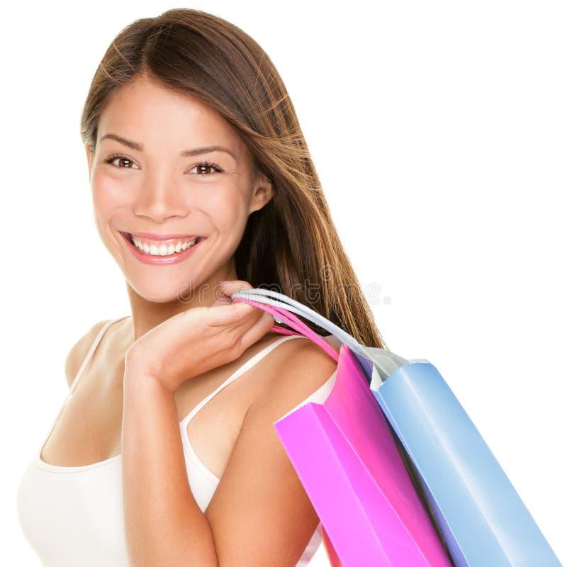 Sacchetti di acquisto della holding della donna del cliente fotografie stock libere da diritti