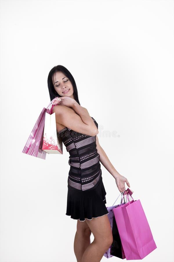 Sacchetti di acquisto di trasporto della donna immagini stock libere da diritti