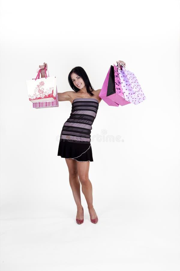 Sacchetti di acquisto di trasporto della donna fotografia stock