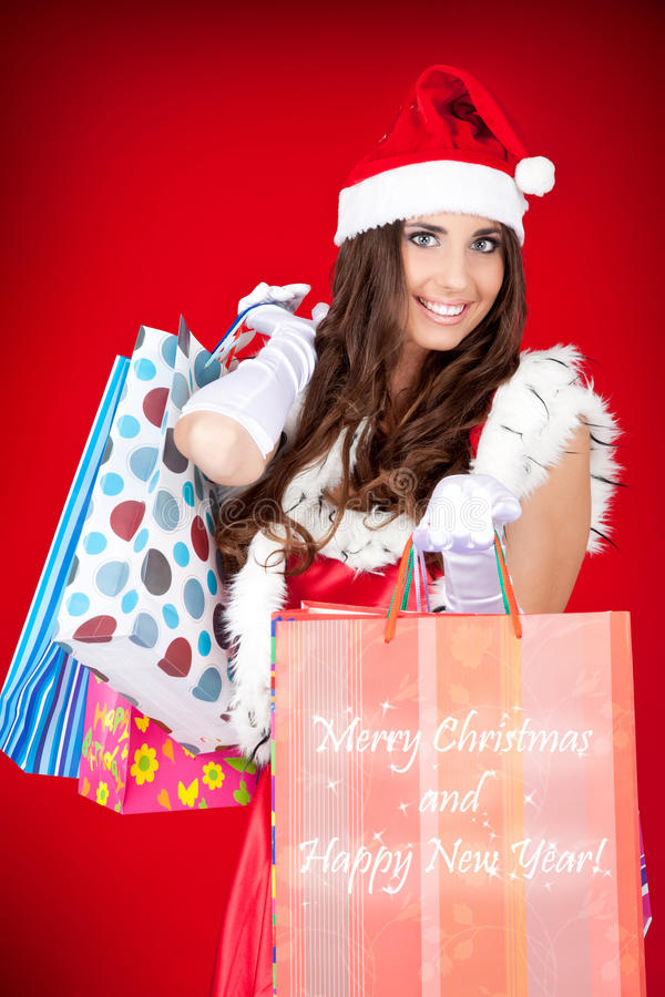 Sacchetti di acquisto sexy della holding della donna della Santa fotografie stock