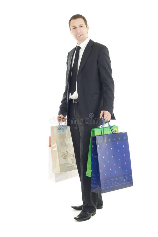 Sacchetti eleganti della holding dell'uomo fotografie stock