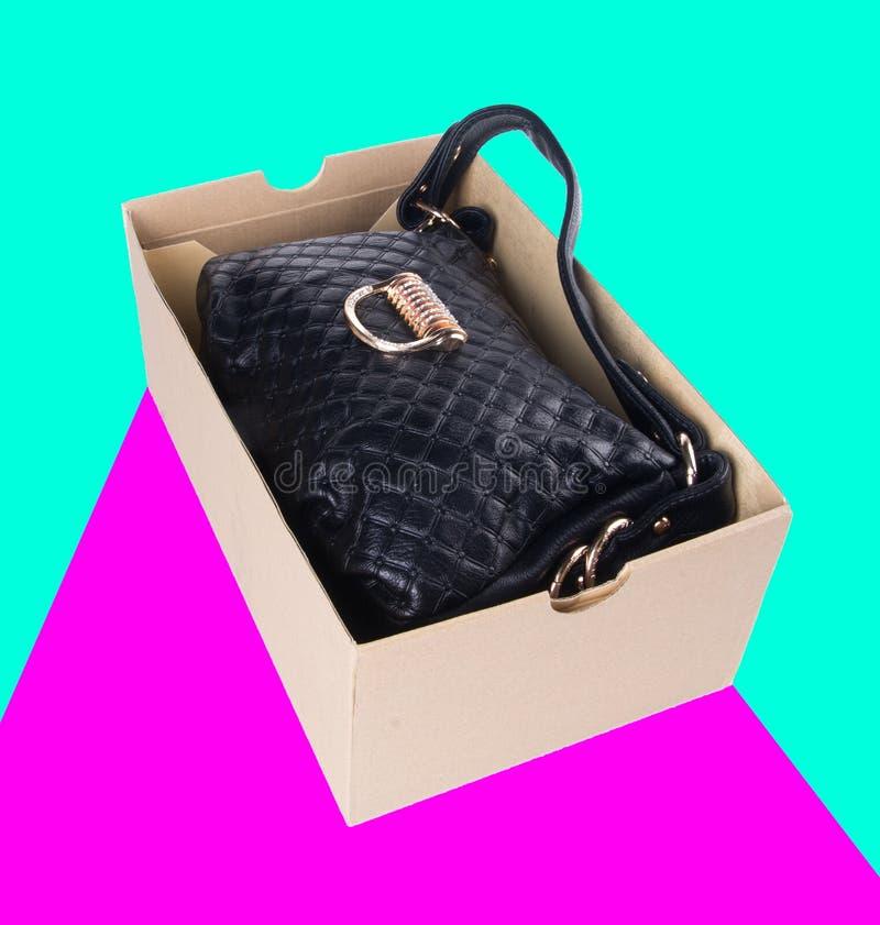 sacchetto borsa delle donne su un fondo fotografia stock