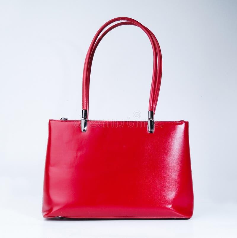 sacchetto borsa delle donne su un fondo fotografie stock libere da diritti