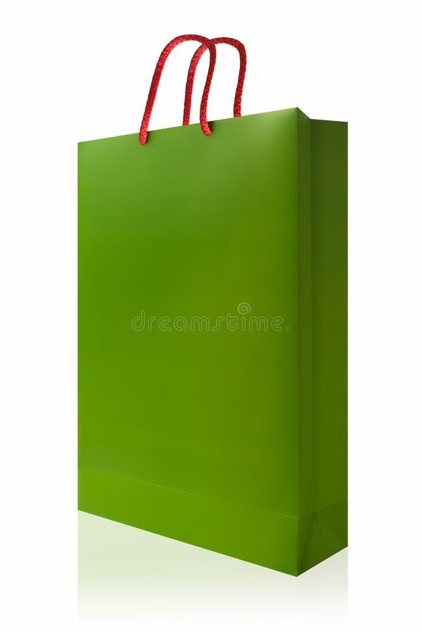 Sacchetto della spesa verde, isolato con il percorso di ritaglio sul backgro bianco immagine stock