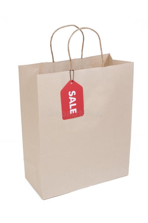 Sacchetto di acquisto con la modifica rossa di VENDITA immagine stock libera da diritti