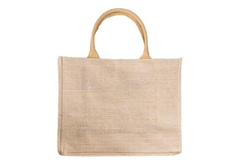 Sacchetto per la spesa fatto di sacchetto Hessian riciclato in maniche di colore marroni naturali isolate su fondo bianco fotografia stock libera da diritti