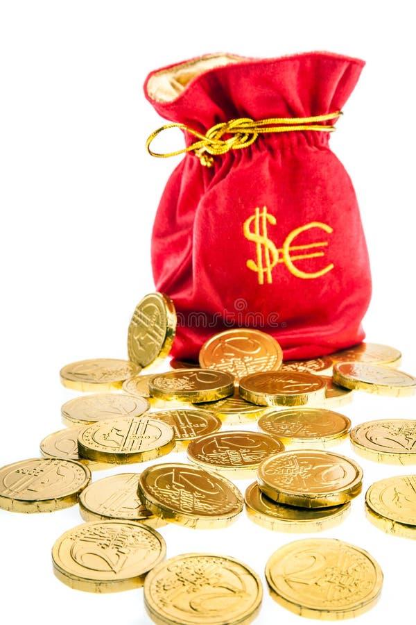 Sacco con l'euro ed i dollari di monete fotografie stock libere da diritti