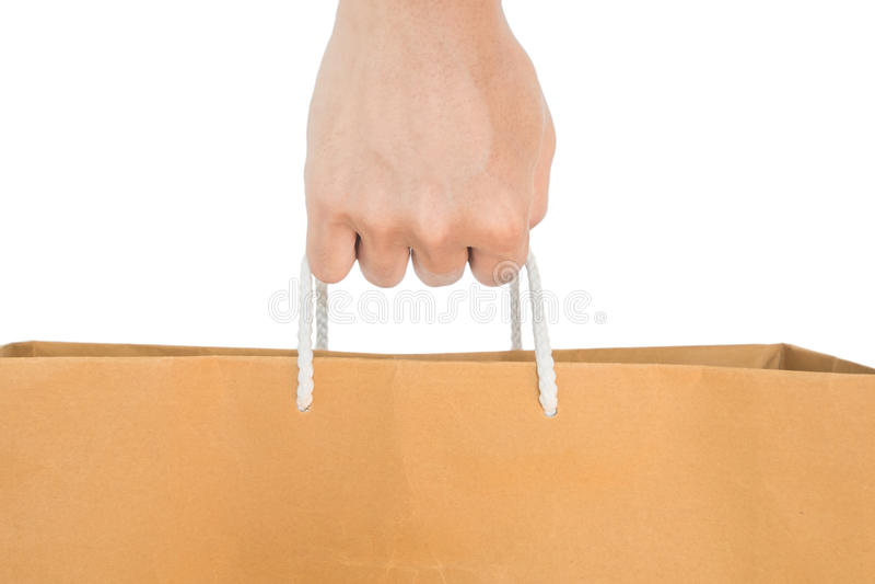 Sacco di carta di riutilizzazione della tenuta della mano, isolato su fondo bianco immagine stock libera da diritti