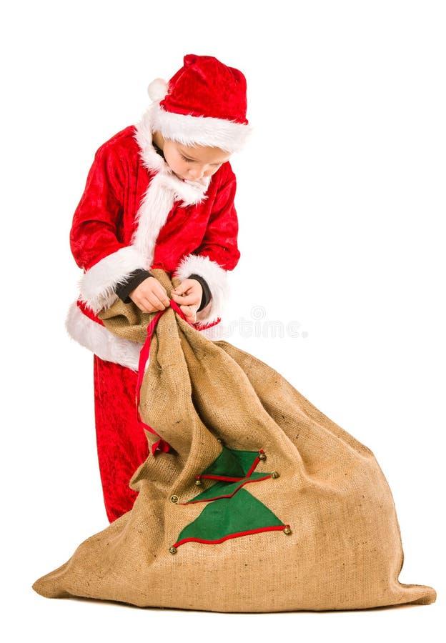 Sacco di Natale e del ragazzo fotografia stock libera da diritti