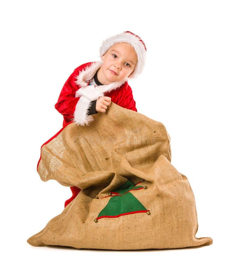 Sacco di Natale e del ragazzo immagini stock