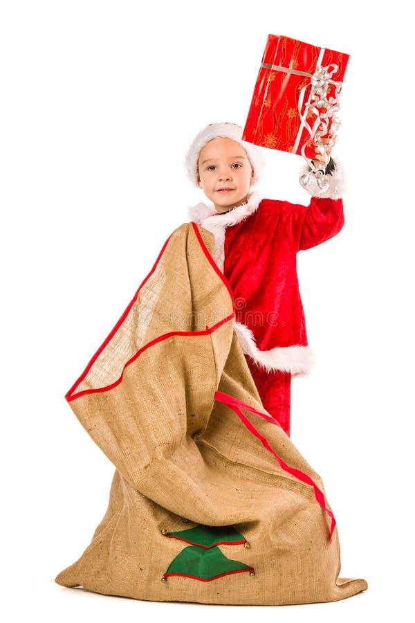 Sacco di Natale e del ragazzo fotografie stock