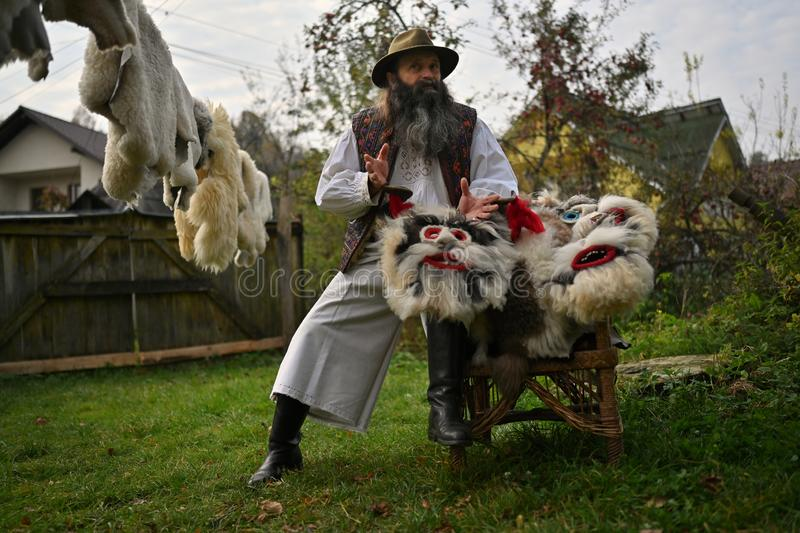 Sacel, Maramures, Romania, October 20, 2018: The man which making masks showing his work. Sacel, Maramures, Romania, October 20, 2018: The man which making masks royalty free stock images