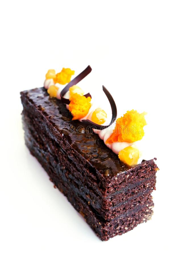 Sacher chocolate cake with apricots and chocolate decorations stock image