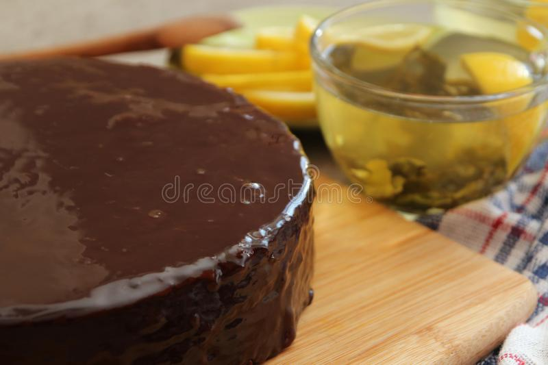 Traditional Austrian Sacher cake. Sachertorte layered with chocolate at traditional recipe of Austria royalty free stock photos