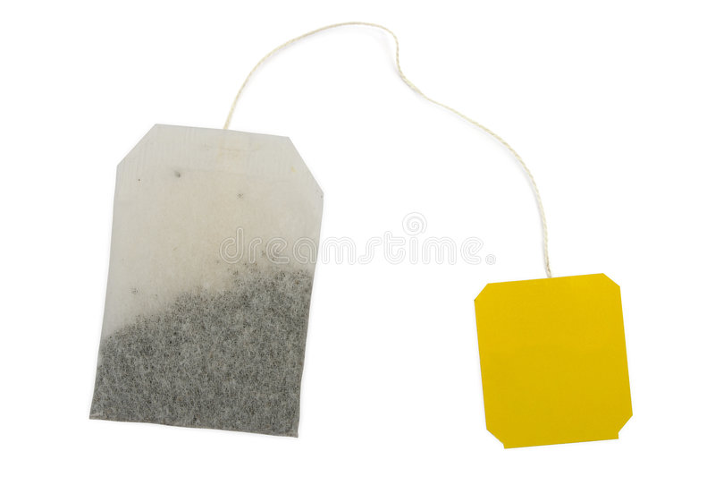 Sachet à thé, étiquette jaune image stock