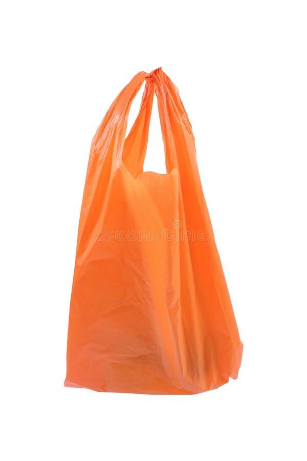 sachet en plastique orange réutilisé d'isolement sur le blanc image libre de droits