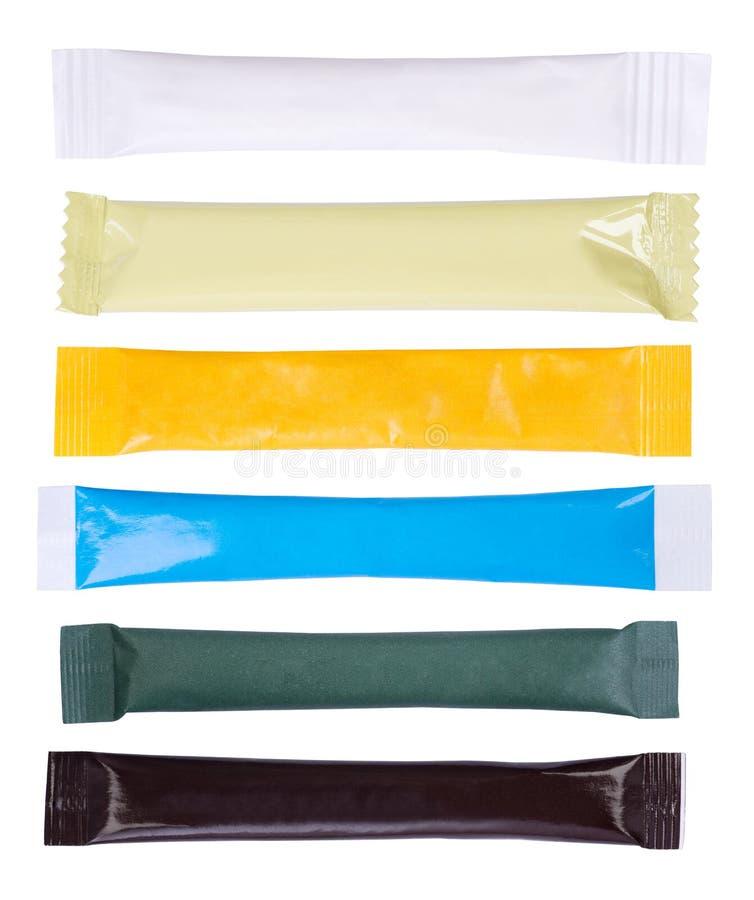 Sachets de papier de sucre d'isolement sur le fond blanc photographie stock