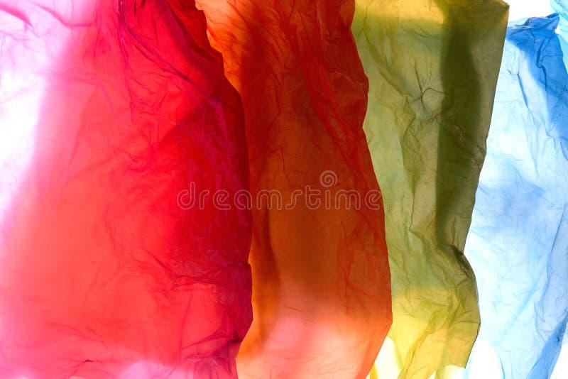 Sachets en plastique de couleurs utilisées et transparentes photo libre de droits