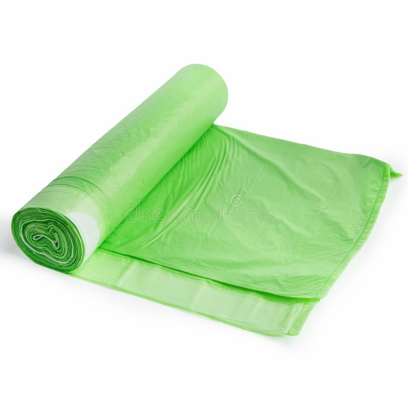 Sachets en plastique verts sur le blanc image libre de droits